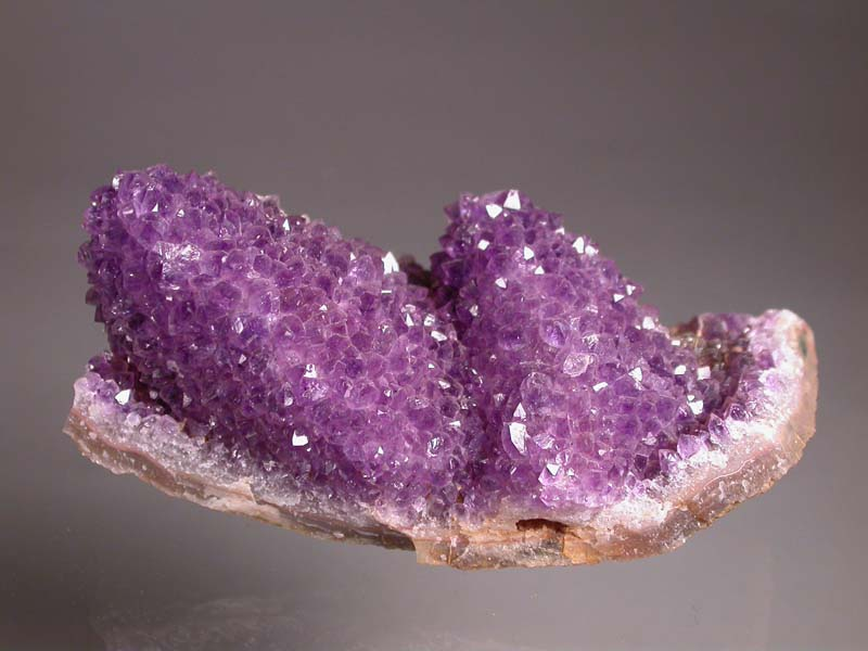 Quartz, var. Amethyst, ps calcite