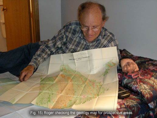 Fig. 15) Roger checking the geology map for prospective areas.