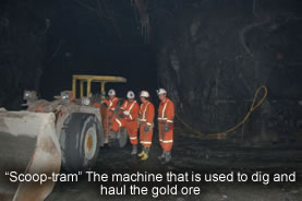 """scoop-tram"" the machine that is used to dig and haul the gold ore"